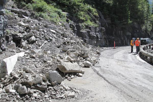Debris from this July 2012 rock slide covered both lanes of the Going-to-the-Sun Road and poured over the edge of the guard rail. July 18, 2012.