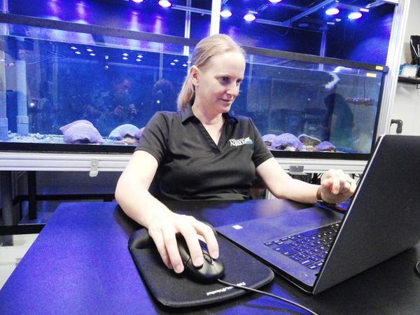 Keri O'Neil regulates conditions in the coral spawning tanks