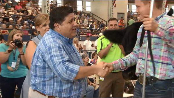 J.B. Pritzker meets Cole Caldwell, 13, of Elmwood at the Illinois State Fair.