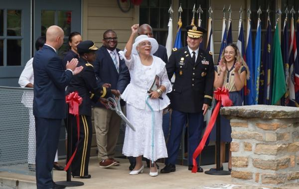 Sammie Ellis (center, in white) joins family members and leaders at Fort Leonard Wood to cut the ribbon at Countee Hall, named for her uncle, Samuel Countee.