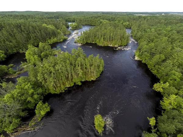A Canadian company is planning to build an open-pit sulfide mine near the Menominee River, which divides Wisconsin and Michigan's Upper Peninsula.