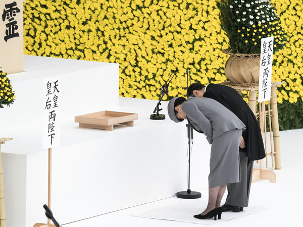 Japanese Emperor Naruhito and Empress Masako bow during a memorial service marking the 74th anniversary of Japan's surrender in World War II at the Nippon Budokan hall on Thursday in Tokyo.