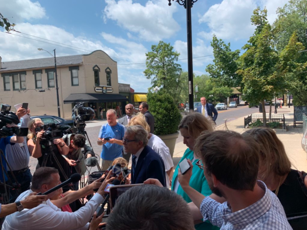 Ohio Gov. Mike DeWine, joined by Dayton Mayor Nan Whaley (right), talks to reporters in Dayton's Oregon District following a mass shooting there that left nine dead and 27 injured.