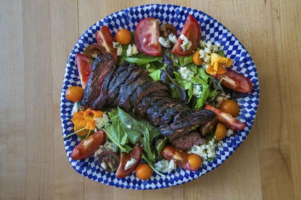 Chef Kathy Gunst's grilled steak salad with blue cheese, tomatoes,  and greens. (Jesse Costa/WBUR)