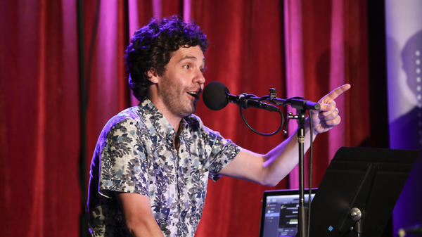 Guest musician Julian Velard leads a music parody game on <em>Ask Me Another</em> at the Bell House in Brooklyn, New York.
