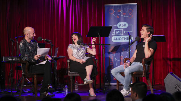 Cecil Baldwin and Ophira Eisenberg lead an <em>Ask Me Another</em> challenge with Antoni Porowski at the Bell House in Brooklyn, New York.