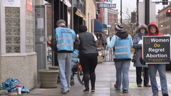 Lindsay Beyerstein's documentary 'Care in Chaos' captured protesters outisde of an abortion clinic and clinic escorts walking with patients.