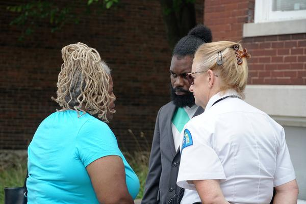 Mary Norwood, the grandmother of 7-year-old Xavier Usanga, speaks to Alderman Brandon Bosley, D-3rd Ward, and Maj. Mary Warnecke, the deputy commander of the Bureau of Investigations, on Tuesday. Xavior was the seventh child killed in the city this year.