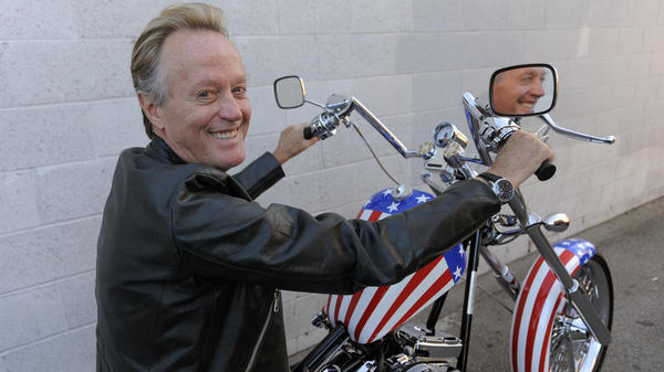 Peter Fonda poses in 2009 atop a Harley-Davidson motorcycle based on the one he rode in the 1969 film <em>Easy Rider</em>.