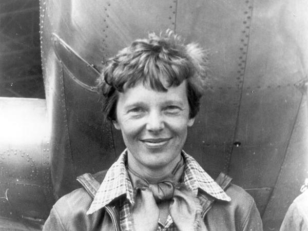 File photo of Amelia Earhart beneath the nose of her Lockheed Model 10 Electra in Oakland, California, in March 1937.