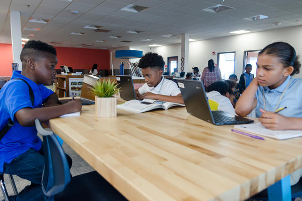 Students work in the library of Kairos Academies, a charter middle school with a non-traditional learning model that has opened in St. Louis.