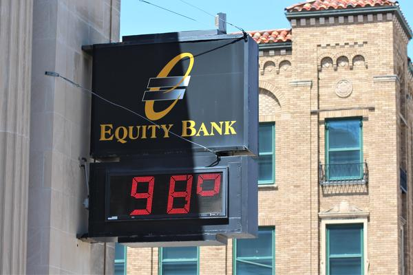 A bank in downtown Topeka reflects recent high temperatures.