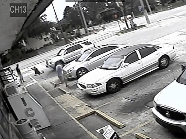 In surveillance video, an unarmed black man Markeis McGlockton (far left) is shot by Michael Drejka, who is white, during an altercation a the parking lot in Clearwater, Fla., in July 2018.