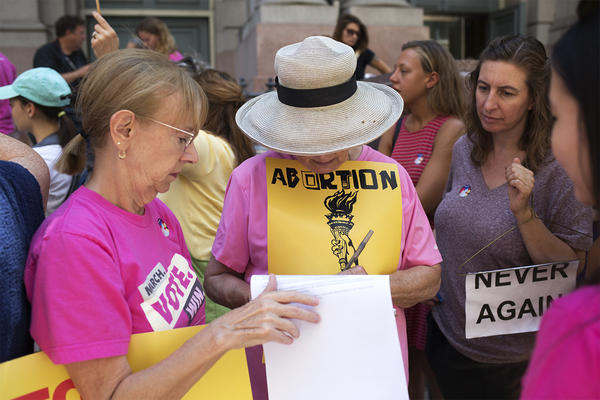 Protesters with the advocacy group No Bans On Choice demonstrate against HB 126 in downtown St. Louis on Aug. 2.