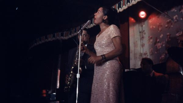 Billie Holiday performs on stage at the Sugar Hill nightclub in Newark, N.J. Farah Jasmine Griffin's 2001 book posed a challenge to biographers and helped reimagine Holiday's legacy.
