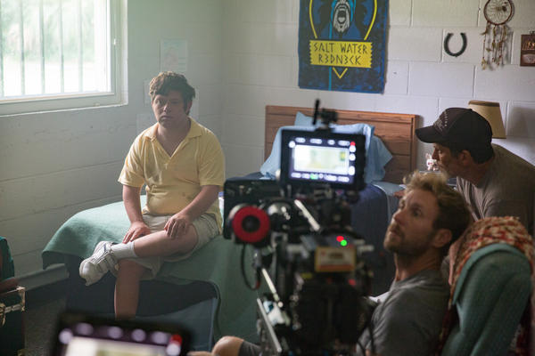 Actor Zack Gottsagen (far left) on the film set of Peanut Butter Falcon with the directors of the movie.