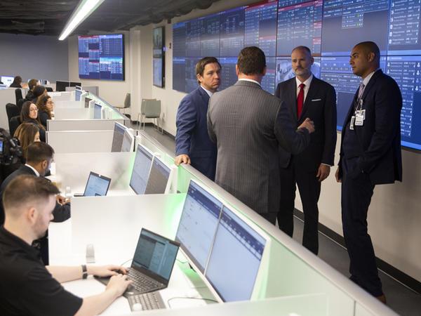 Gov. Ron DeSantis tours Tampa General Hospital's new CareComm command center.