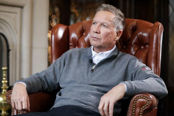 Ohio Gov. John Kasich sits for an interview with The Associated Press at the Ohio Governor's Residence and Heritage Garden, Thursday, Dec. 13, 2018, in Columbus.