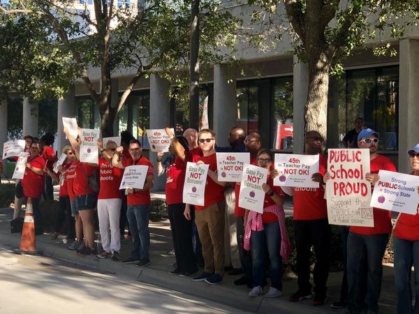 Scores of teachers rallied for better wages ahead of the State Board of Education meeting in Fort Lauderdale, Wednesday, Aug. 21, 2019.