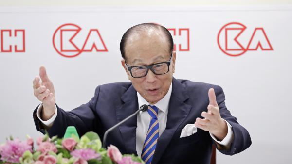 Li Ka-shing speaks at a news conference in Hong Kong last year. The nonagenarian tycoon purchased full-page ads in local newspapers warning against violence — but at least one scholar of Chinese language sees a secret message of support for the protesters.