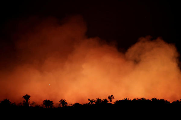 Smoke billows during a fire in an area of the Amazon rainforest near Humaita, Brazil, on Aug. 17.