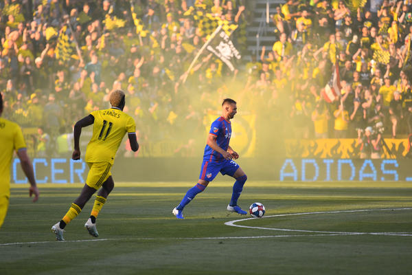 Yellow smoke billows from the stands at Maphre Stadium in Columbus during the first MLS meeting between FC Cincinnati and Columbus Crew SC on Aug. 10, 2019.