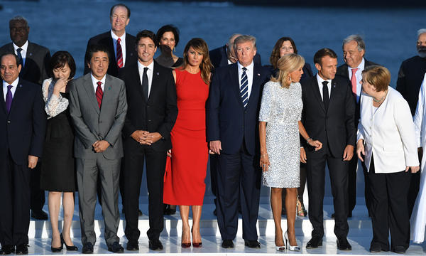 World leaders gather for a group photo at the G-7 summit in Biarritz, France, on Sunday. Summit host and French President Emmanuel Macron and President Trump are holding a joint press conference on Monday.