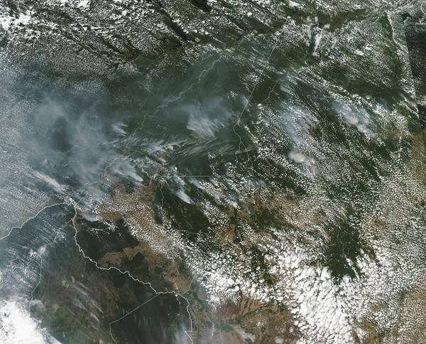 A NASA satellite photo from earlier this month shows smoke from the record number of fires burning across Brazil's Amazon rainforest region this year.