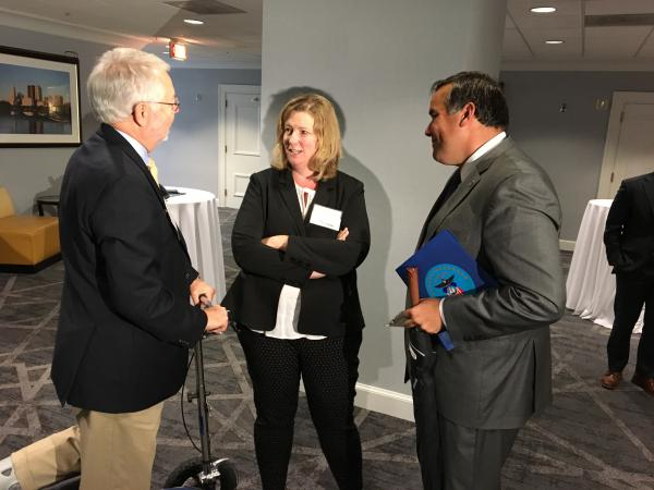 Mayor David Scheffler (R-Lancaster, left) talks with Mayor Nan Whaley (D-Dayton) and Mayor Andrew Ginther (D-Columbus). They were at the Ohio Mayors Alliance luncheon where seven cities received more than $200,000 for local educational projects.