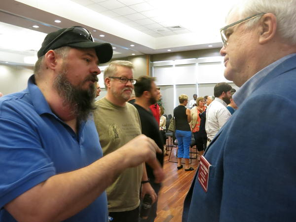 Gun rights advocate Neal Shera spoke to Kansas Rep. Jerry Stogsdill after a roundtable discussion in Overland Park, Kansas.