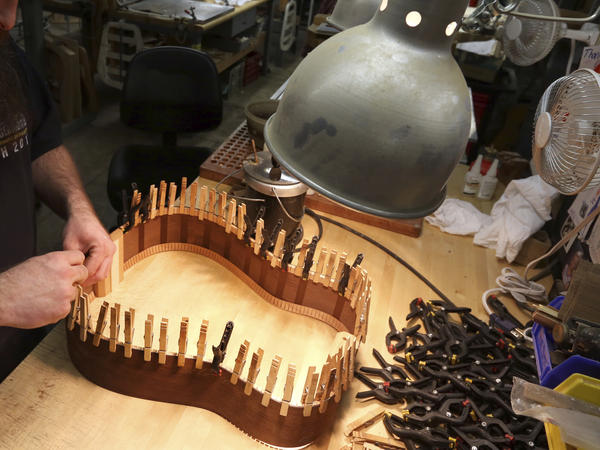A luthier assembling the rosewood sides of a guitar at C. F. Martin and Co., in Nazareth, Pa. Instrument makers and musicians may soon be able to transport instruments containing rosewood around the world, despite concerns from conservationists.