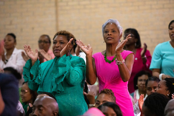 Members of Alpha Kappa Alpha Sorority clap along with a hymn during a worship service at St. Joseph's AME Church in Durham, N.C., Sunday, Aug 25, 2019. Democratic presidential candidate Kamala Harris is a member of the sorority.