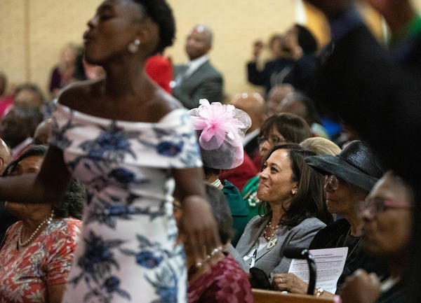 Democratic presidential candidate Kamala Harris, bottom right, listens to music during a worship service at St. Joseph's AME Church in Durham, N.C., Sunday, Aug 25, 2019.