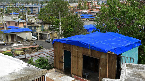 Homes in the Cantera area of San Juan, Puerto Rico, are covered with FEMA tarps after Hurricane Maria. The island is now bracing for another major storm.