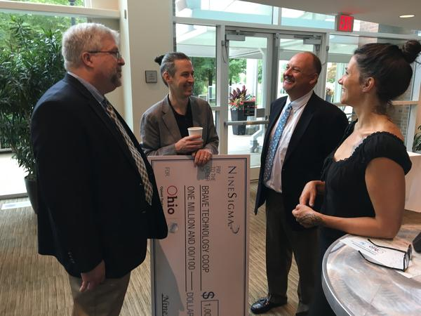 Kevin Andrews of Nine Sigma (left) talks with Ohio Opioid Technology Challenge winners Gordon Casey (second from left) and Oona Krieg (right) of Brave Technology.