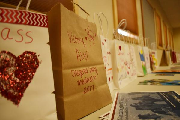 Over 100 paper bag luminaries lined the back of a conference room in Pablo, MT Aug. 27, 2019. The luminaries represent missing and murdered indigenous Montana women dating back to the early 1900s.