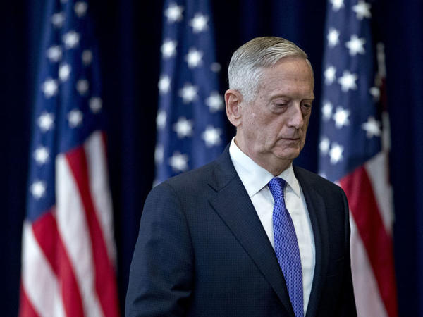 James Mattis, then U.S. secretary of defense, leaves a news conference following a meeting about U.S.-China diplomacy and security at the State Department in Washington, D.C., in June 2017. Mattis' new book, <em>Call Sign Chaos, </em>implies criticism of President Trump without taking direct shots at him.