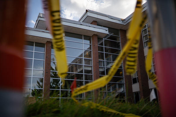 A view of the College of Law building at the University of Illinois at Urbana-Champaign, including construction tape.