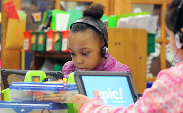 Students at Broken Arrow Elementary in the Shawnee Mission School District develop reading skills using iPads. Every student in the district receives an iPad or Macbook.