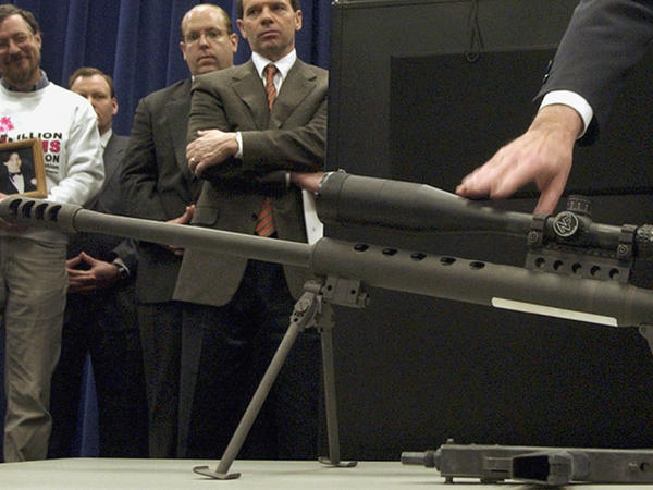 Local officials point to a .50-caliber assault weapon during a 2005 news conference in Chicago, a year before Cook County officials enacted an assault weapons ban. The law has been upheld by trial and appeals courts. On Thursday, a federal appeals court again kept the law in place.