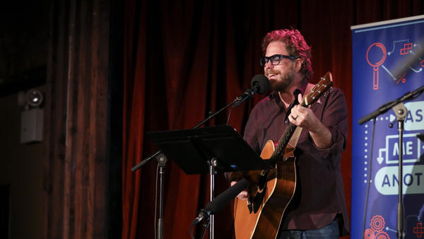House musician Jonathan Coulton leads a music parody game on <em>Ask Me Another</em> at the Bell House in Brooklyn, New York.