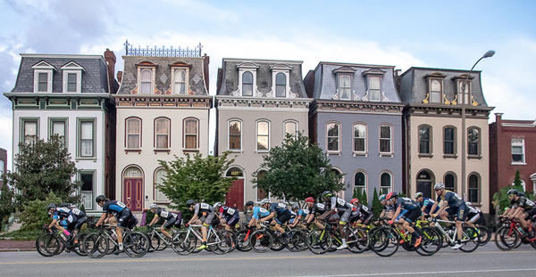 Several cyclists zoom though the Lafayette Square neighborhood during the 2018 edition of the Gateway Cup.