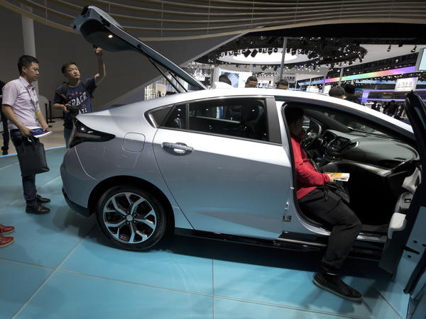 Visitors to the 2017 Shanghai Auto Show take a look at Buick's Velite 5, among the cars made and sold by General Motors in China.