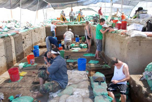 <p>Archaeologists work to excavate ancient human artifacts at Cooper's Ferry in Western Idaho.</p>