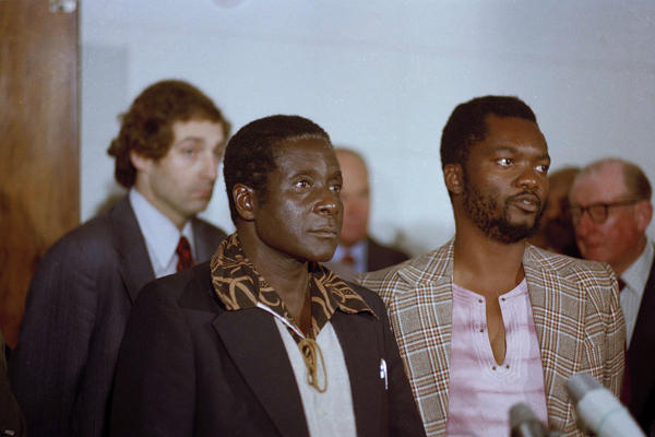 Zimbabwe African National Union leader Robert Mugabe in Geneva, Switzerland, 1976. Others are unidentified.