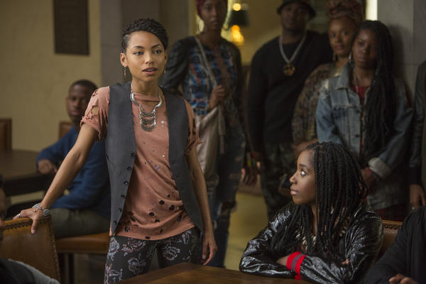 Actresses Logan Browning (left) and Ashley Blaine Featherson appear in a scene from the Netflix show <em>Dear White People</em>.