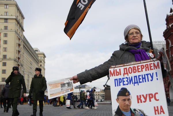 A supporter of Russian President Vladimir Putin campaigns for him in Red Square in central Moscow.