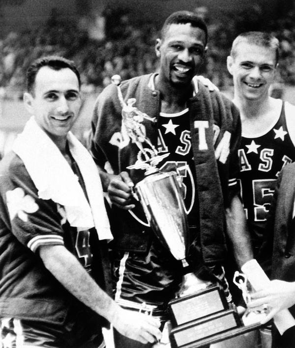 Bob Cousy (left), Bill Russell (center) and Tom Heinsohn (right), all teammates on the Boston Celtics, pose after the 1963 NBA All-Star Game. Russell won the game's MVP award.