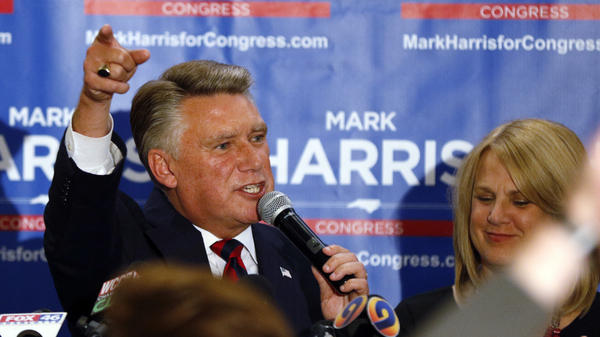 North Carolina 9th district Republican congressional candidate Mark Harris, with his wife Beth, claims victory in his congressional race in Monroe, N.C. The race, however, has yet to be certified as authorities look into fraud claims in the eastern part of the district.