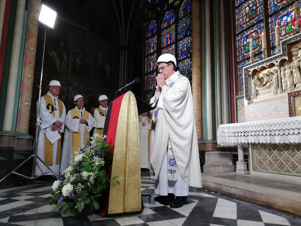 A small group in hard hats gathered on Saturday for Mass in Paris' Notre Dame cathedral. It was the first Mass since a fire devastated the church in April.